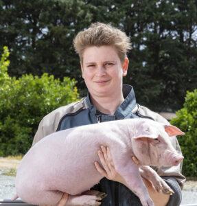 Éleveuse de porcs